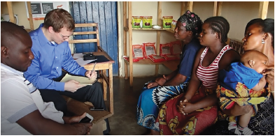 UNH student Abraham DeMaio interviews farmers with Ziweto co-founder Byton Simwela.