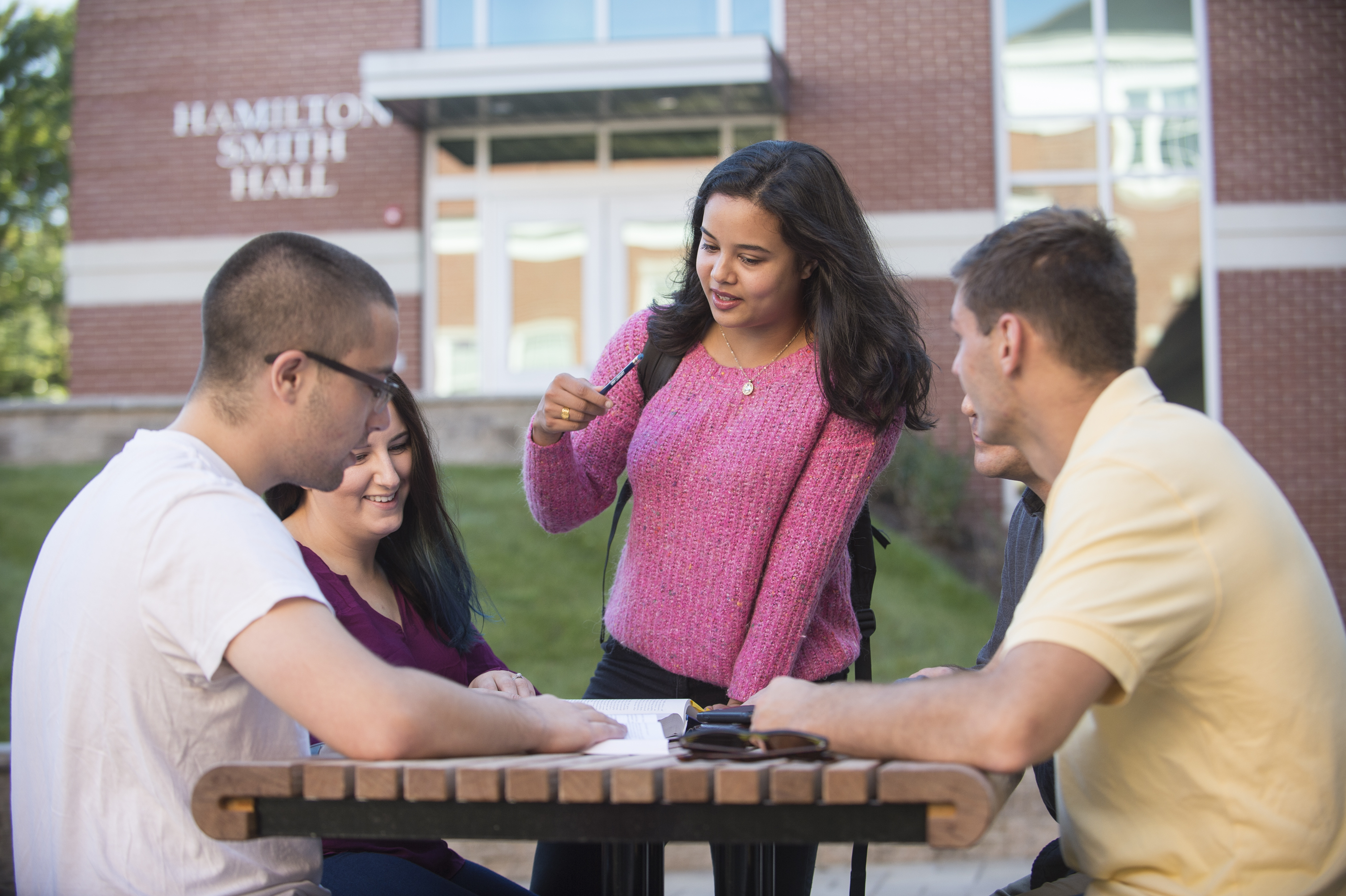 Image of students working together in front of Hamilton Smith Hall
