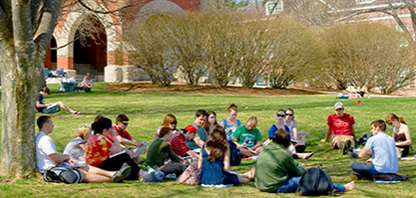Image of group of students in a group discussion outside