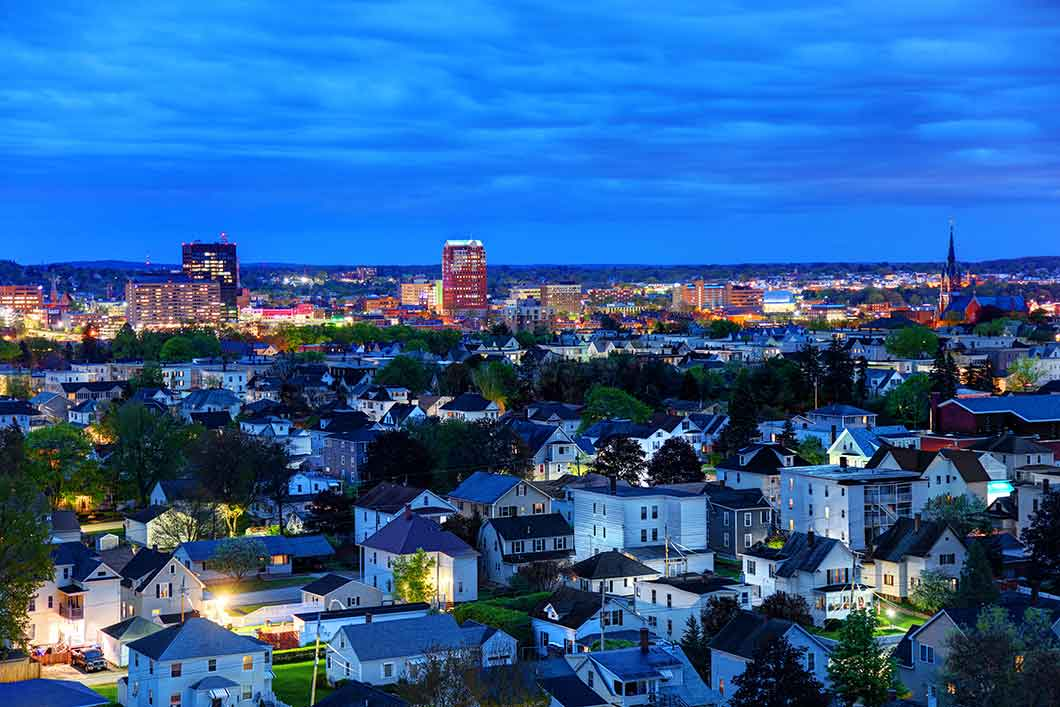 Photo of Manchester, NH, at night.