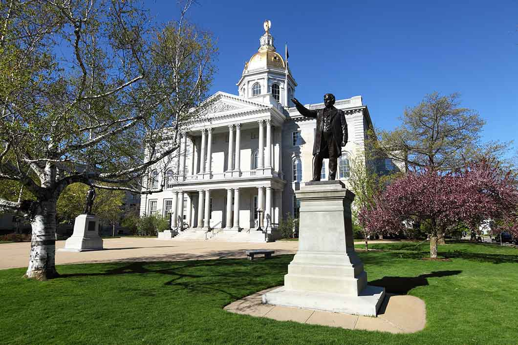 Photo of statue in front of New Hampshire State House.