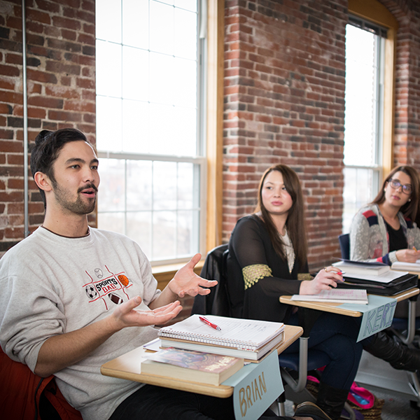 An MPA student speaking in class