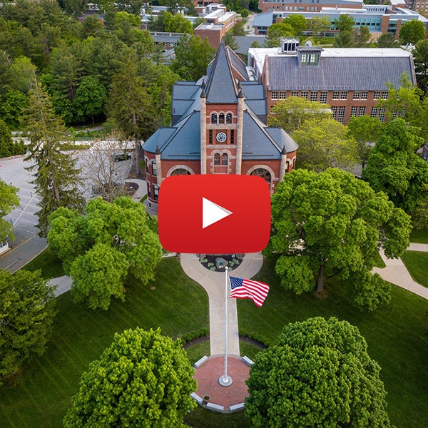 A photograph of thompson hall from the air with the youtube play button superimposed on the image