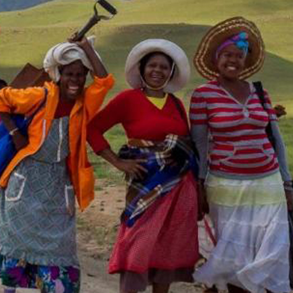 Three african women walking to a Sustainable Microfinance conference