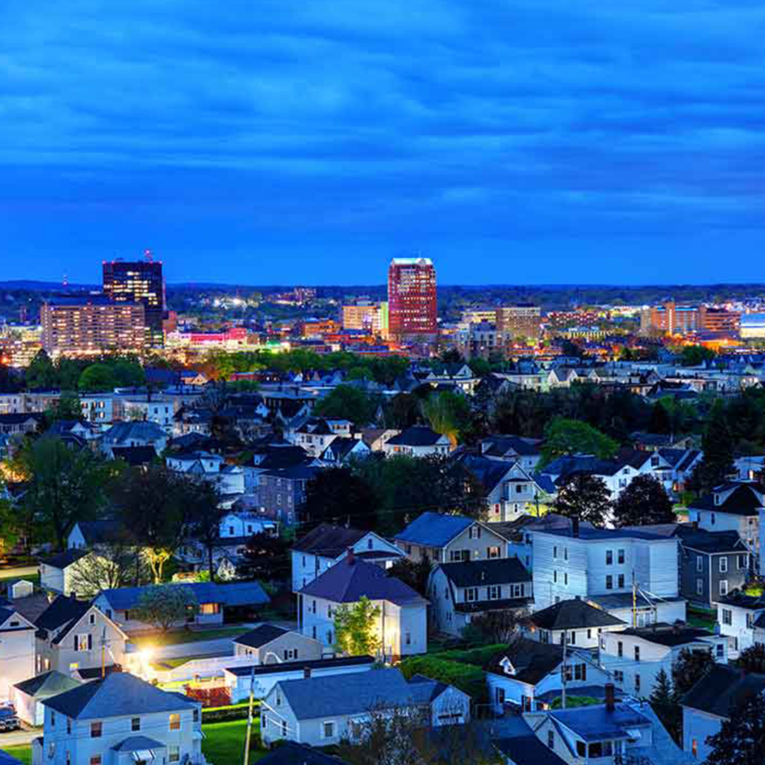 A skyline at dusk of Manchester, New Hampshire