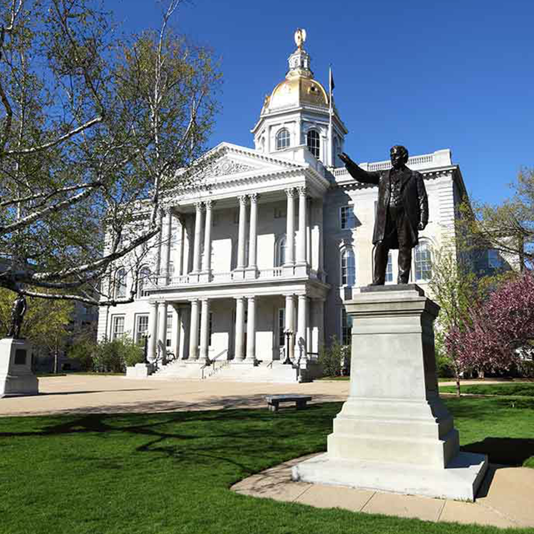 A photograph of the NH Statehouse/Capitol building during the day