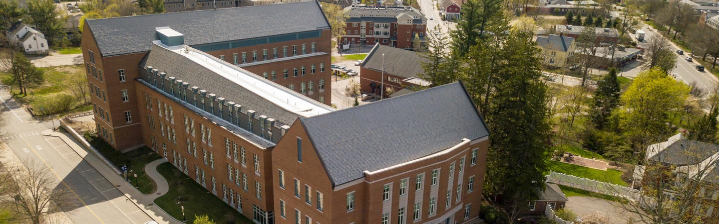A photograph showing Paul College at UNH, from which S. Melvin Rines graduated from