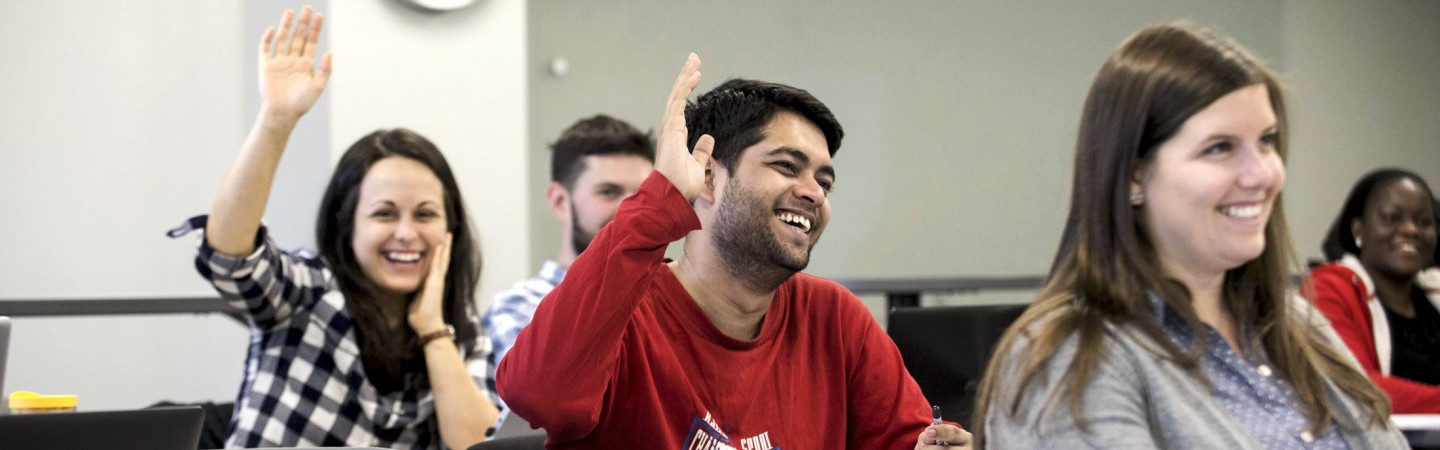 Students raising their hands in a Public Policy class.