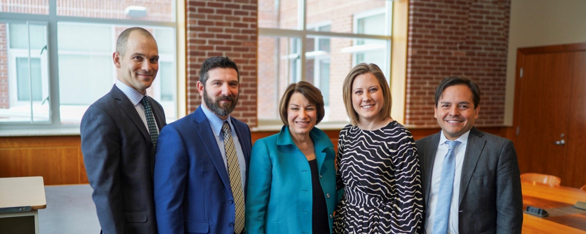 Sen. Amy Klobuchar with (from left) Jed Herrmann (Results For America), Dan Bromberg (Carsey School), Sadie O'Connor (Minnesota Reading Corps), and David Medina (Results For America).