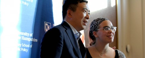 Andrew Yang standing with a student.