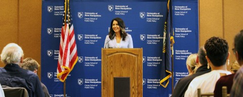 Tulsi Gabbard at the podium in Huddleston Hall, UNH.