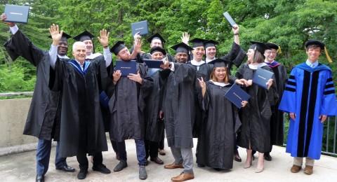 Community Development degree graduates and instructors celebrating.