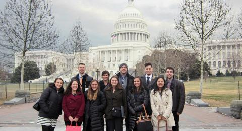 A photo of public policy students standing in front of the U.S. Capitol building in Washington, D.C.