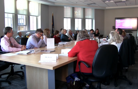 New Hampshire Commission to Study School Funding members sit around a conference table