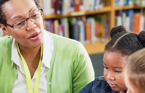 An instructor speaking with grade-school children