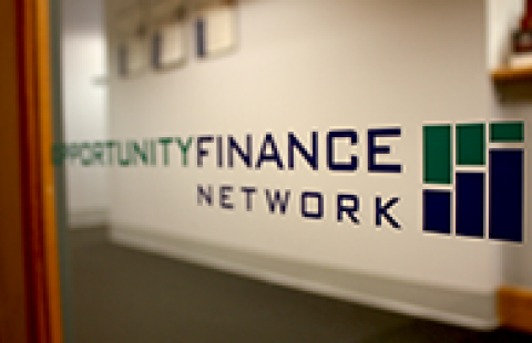 A sign with the opportunity finance network logo showing on it
