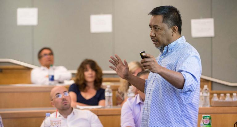 A photo of Jolan Rivera, a Carsey School faculty member, teaching a Master in Community Development course