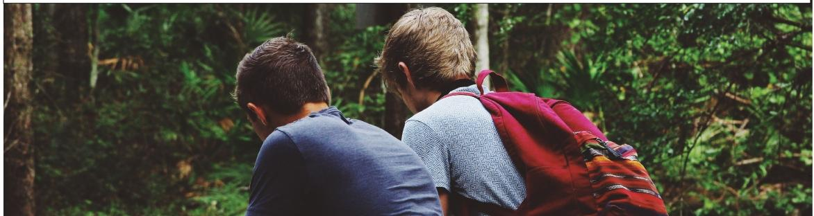 Image of two students in the woods